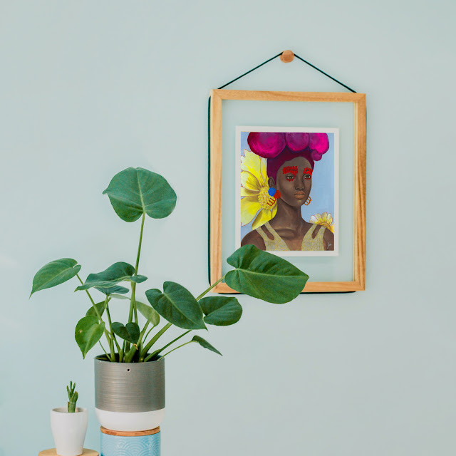 Original print of a black woman in colorful accessories by The Monarq