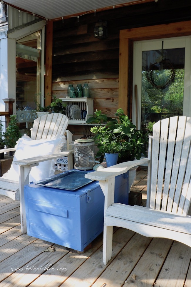 Rustic blue box on back porch has a new coat of exterior blue paint