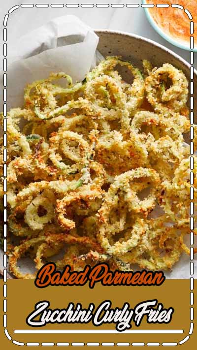 This healthy recipe combines two bar food favorites—fried zucchini and curly fries—into one tempting package. Serve these baked zucchini fries with a simple dipping sauce made with ranch dressing and marinara sauce for a crowd-pleasing appetizer or a side dish for burgers, chicken or pizza. #comfortfood #comfortfoodrecipes #healthycomfortfood #healthycomfortfoodrecipes #recipe #eatingwell #healthy