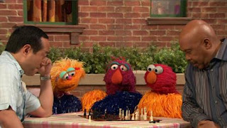 Gordon and Alan play chess. Elmo, Zoe and Telly start to do their cheering without noise. Sesame Street Episode 4420, Three Cheers for Us, Season 44
