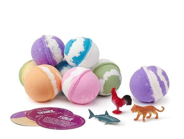 Multicolored bath bombs with toys inside