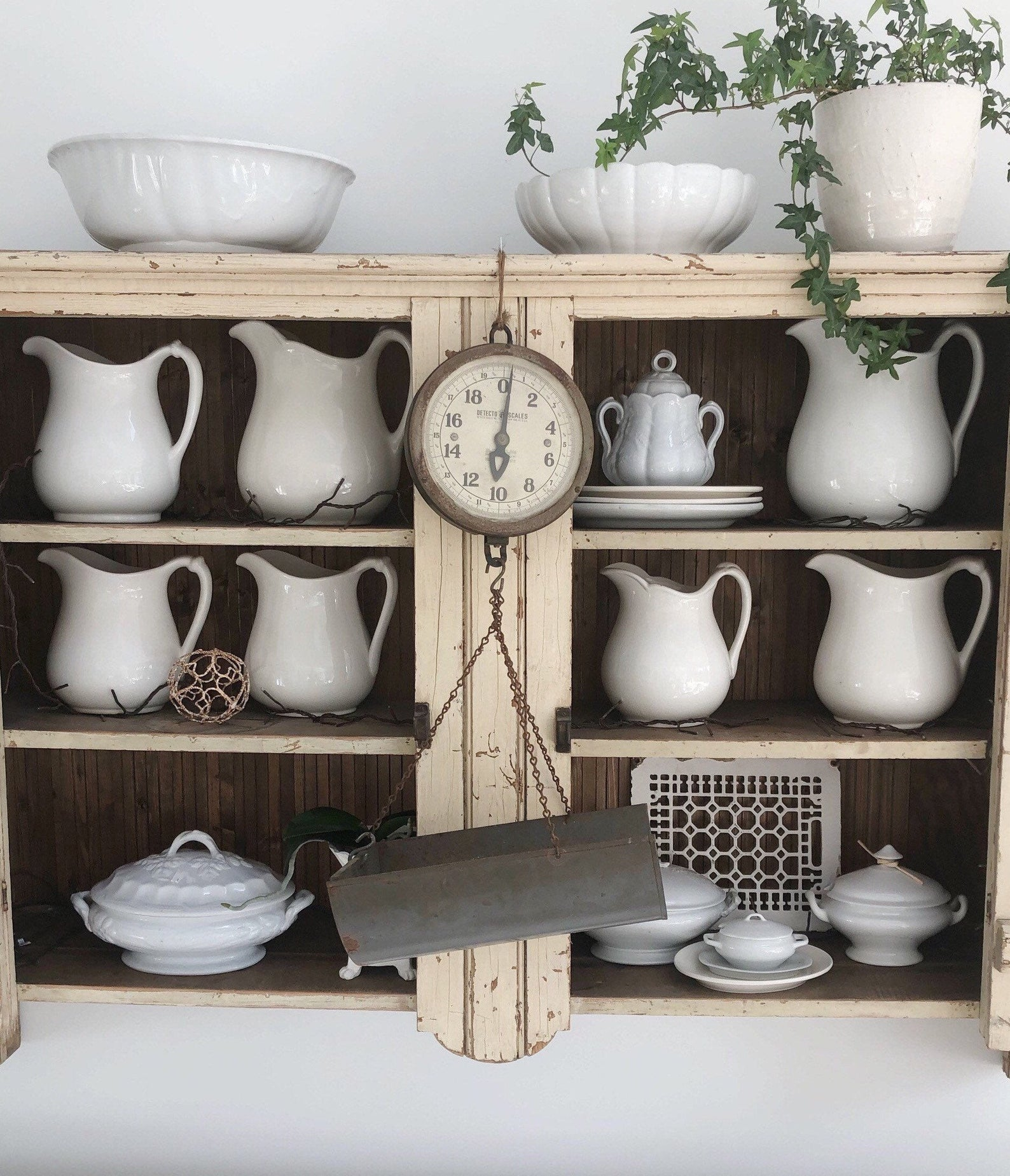 Ironstone pitcher collection in a vintage hutch cabinet