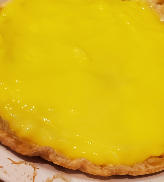 this is homemade lemon pie filling in a homemade pie crust