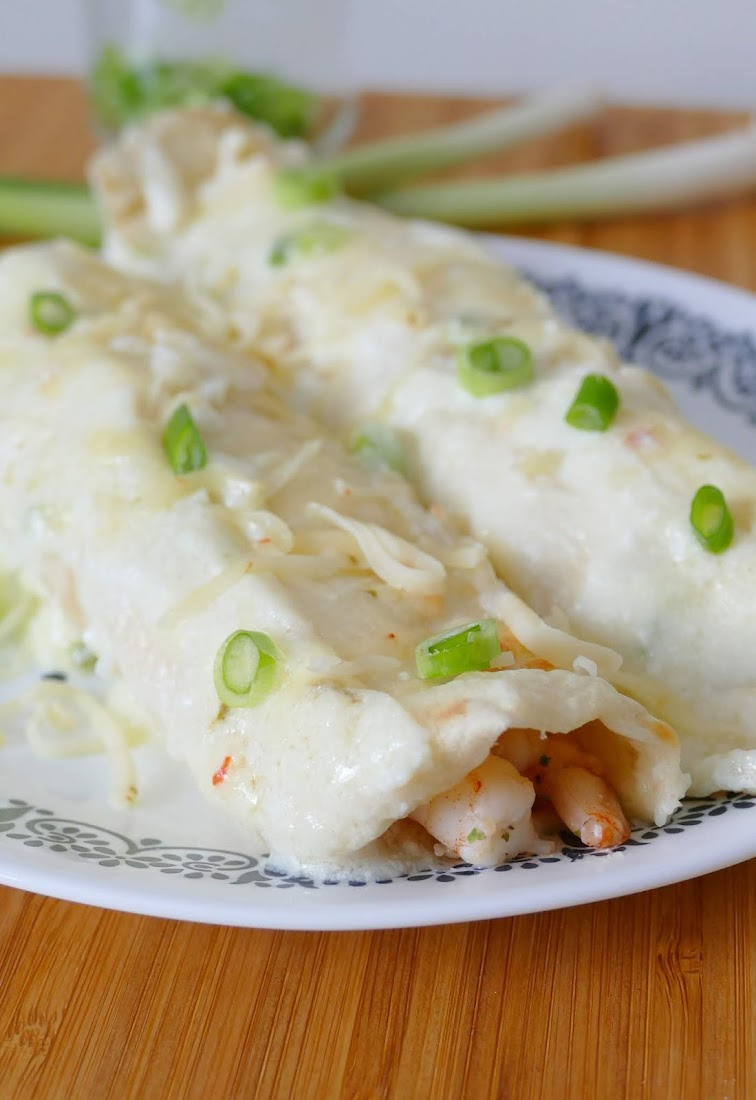 These unique and delicious shrimp and crab enchiladas with a creamy sauce are perfect for dinner any night of the week! Pepper jack cheese, jalapeno and garlic add so much flavor to this Mexican comfort food meal!