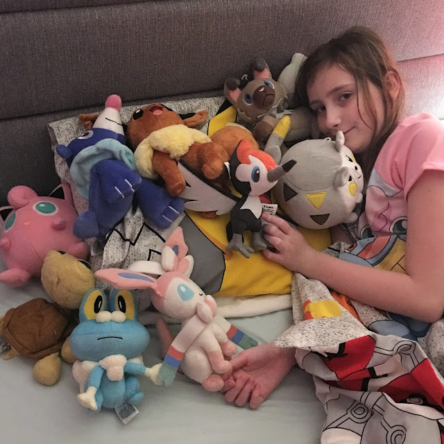 Sasha with her Pokemon plush toys