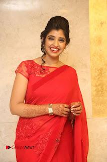 Actress Shyamala Stills in Red Saree at Okkadochadu Movie Audio Launch .COM 0368.JPG