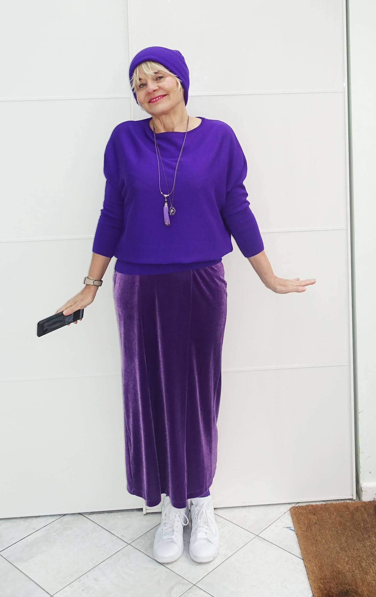 A dressed-down look for a velvet skirt for Is This Mutton style blogger Gail Hanlon as she creates a monochrome purple outfit with white trainers