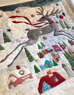 snowdrifts and snowflake quilting on a reindeer quilt