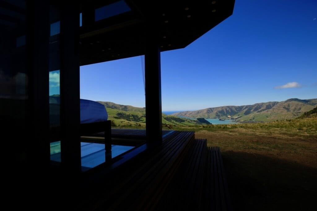 05-Coffee-on-the-Deck-New-Zealand-PurePods-Glass-Tiny-House-Architecture-www-designstack-co