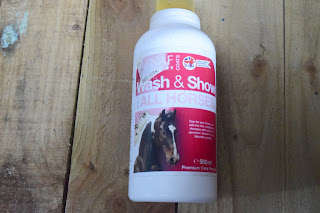 A bottle of wash & show Horse Shampoo