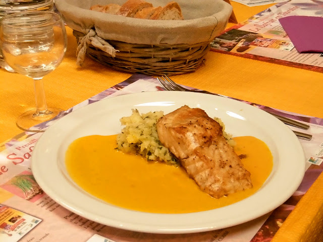 Main course of sturgeon with herbed mashed potato and carrot saffron sauce.  Indre et Loire, France. Photographed by Susan Walter. Tour the Loire Valley with a classic car and a private guide.