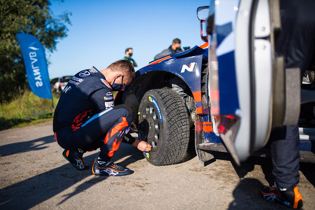 Rally Driver changing wheels before stage start