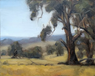 Landscape oil painting of a eucalypt with distant trees and hills.