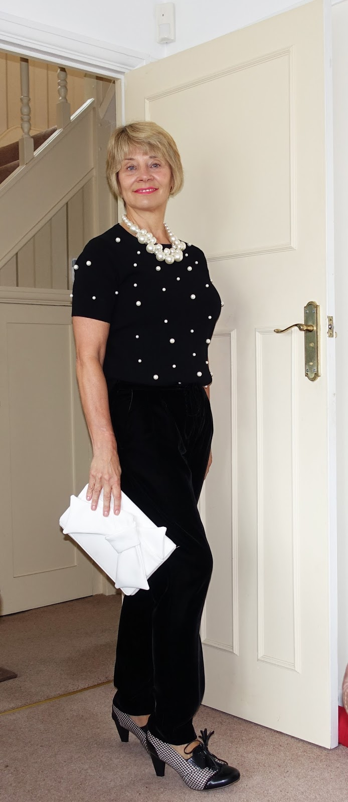 Is This Mutton features a glamorous evening look for women over 40 with velvet trousers and a pearl embellished top