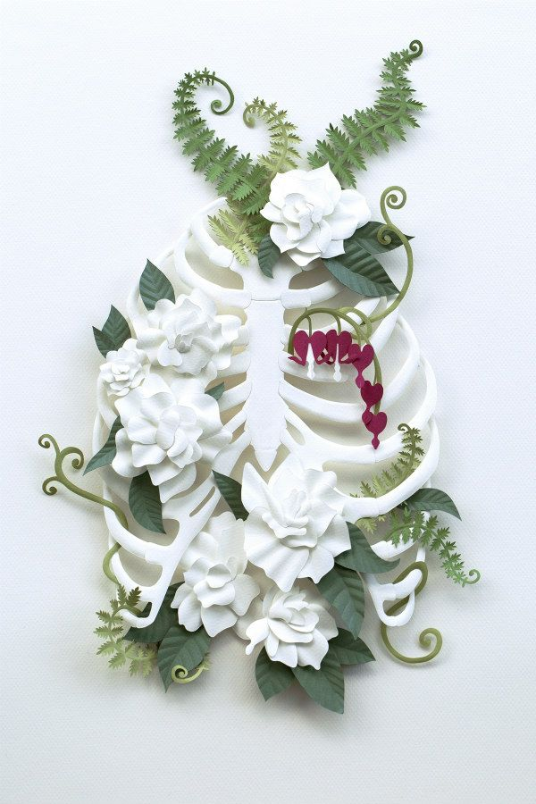 green, white, and red paper sculpture with rib cage, bleeding heart flowers, and fern foliage