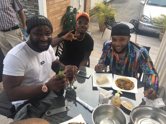Harrysong, Kcee and Skibii pictured having lunch together