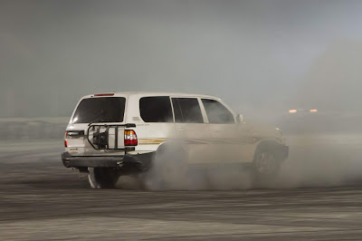 SUV Drifter throttle up before making a sharp J turn
