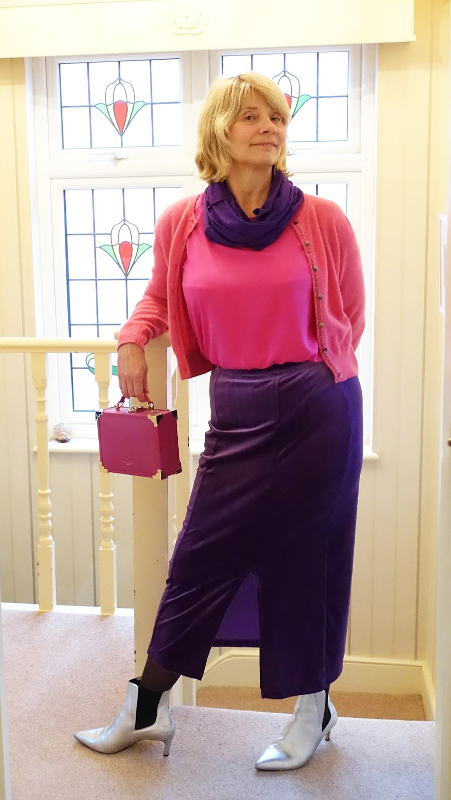 Silver ankle boots with a velvet midi violet skirt and pink top and cro