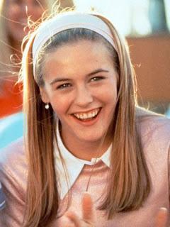 garota dos anos 90 sorrindo loira usando faixa de cabelo