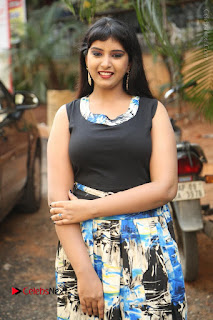 Actress Model Poorni Stills in Floral Long Dress at Silk India Expo Launch  0010.JPG