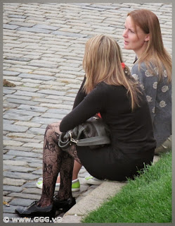 Girl in black pantyhose on the street