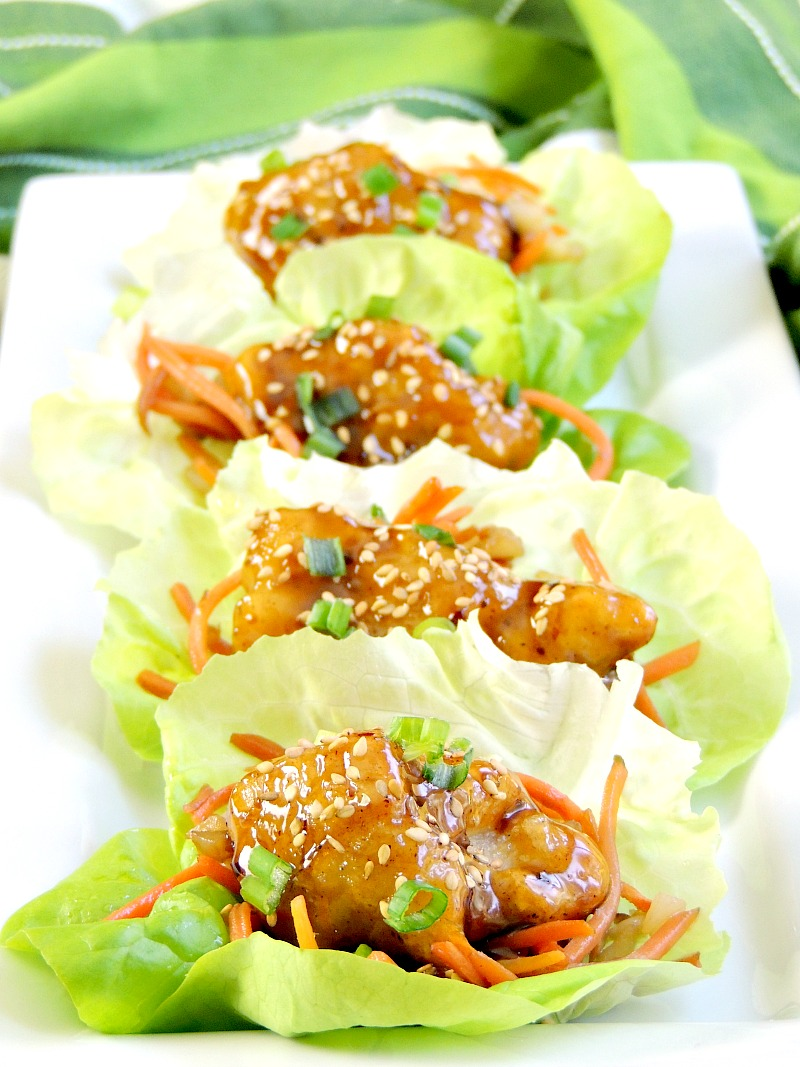General Tso's Chicken Lettuce Wraps - Quick and easy to make, these lettuce wraps take appetizers to the next level by combining that classic Chinese entree with a favorite appetizer. The result is nothing short of delicious! #appetizer #Asian #chicken From www.bobbiskozykitchen.com