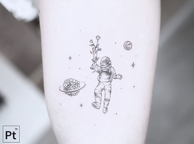astronaut playing with tree tattoo