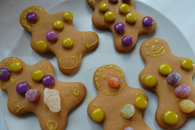 Child decorating gingerbread men