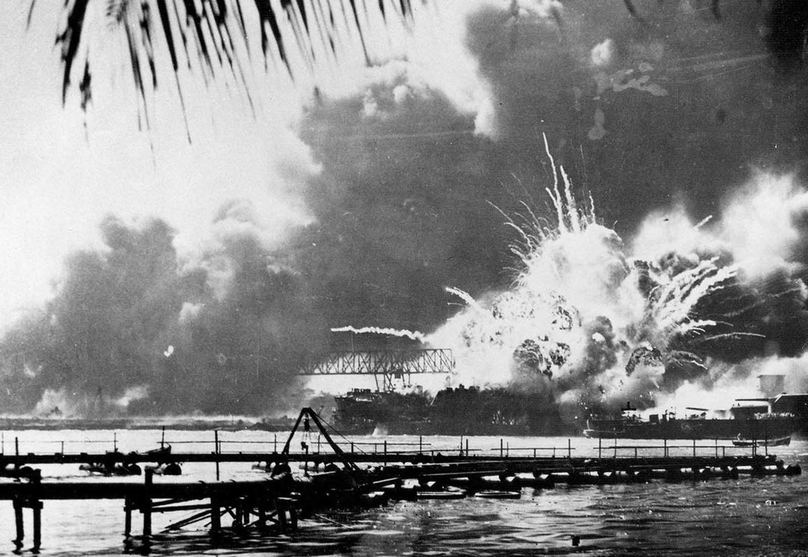The USS Shaw explodes after being hit by bombs during the Japanese surprise attack on Pearl Harbor, Hawaii, in this December 7, 1941 photo.