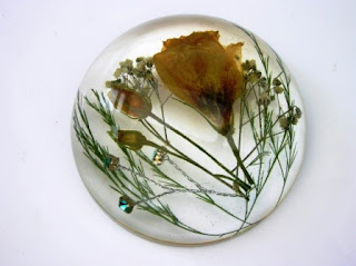 Wedding flowers preserved within a paperweight