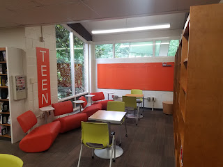 welcoming teen space with furniture orangeboard and teen sign