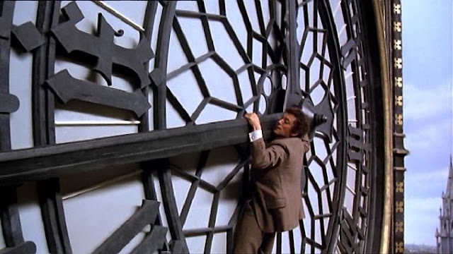 Robert Powell hanging off clock face of Big Ben in The Thirty Nine Steps