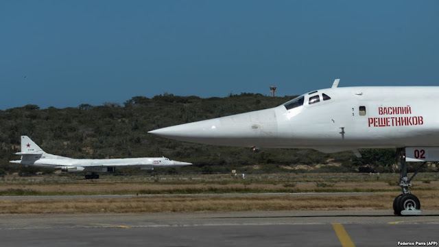 Image Attribute: Tu-160s at Maiquetia airport outside Caracas / Source: Federico Parra (AFP)