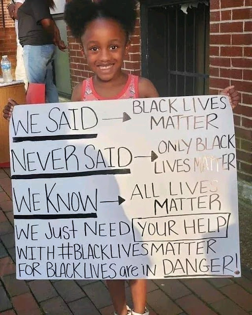 Black girl with a Black Lives Matter sign