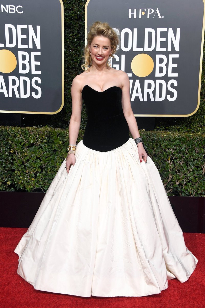 Amber Heard stands out in strapless black and white ballgown on the red carpet at the Golden Globes