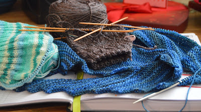 a look at what's on the knitting needles today. Hitchhiker scarf, hat & socks.