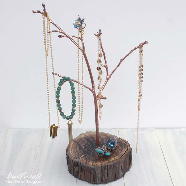 Tree branch jewelry organizer using a real tree branch and resin.