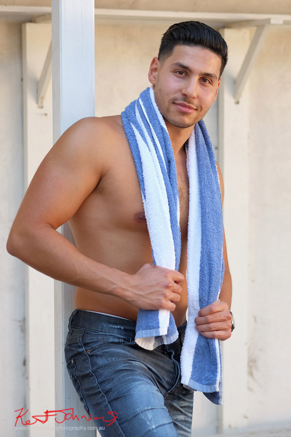 Long mid shot in colour with towel and a happy grin. Male modelling portfolio shot on Location in Sydney Australia by Kent Johnson.