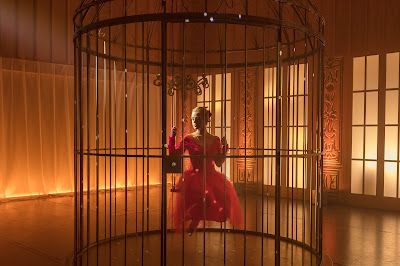 "Lena trapped in a cage as Clara in a reimagining of ""The Nutcracker"""