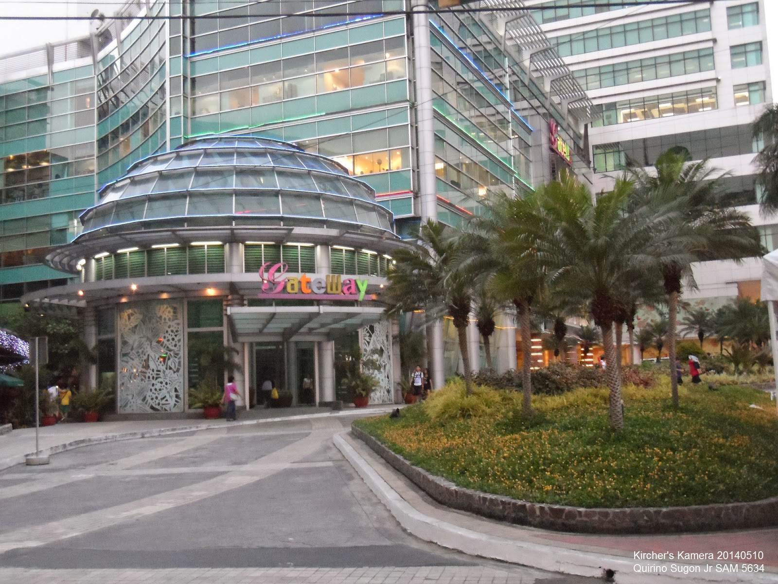 Gareway Mall's main entrance.  On the right are the grass and palm trees. The overall effect is an oasis in the desert.