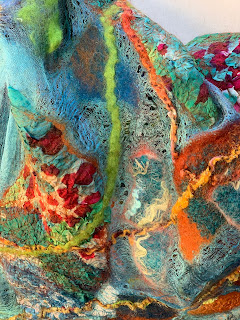 Margilan silk felted with prefelt pieces made with wool and hand painted silks.