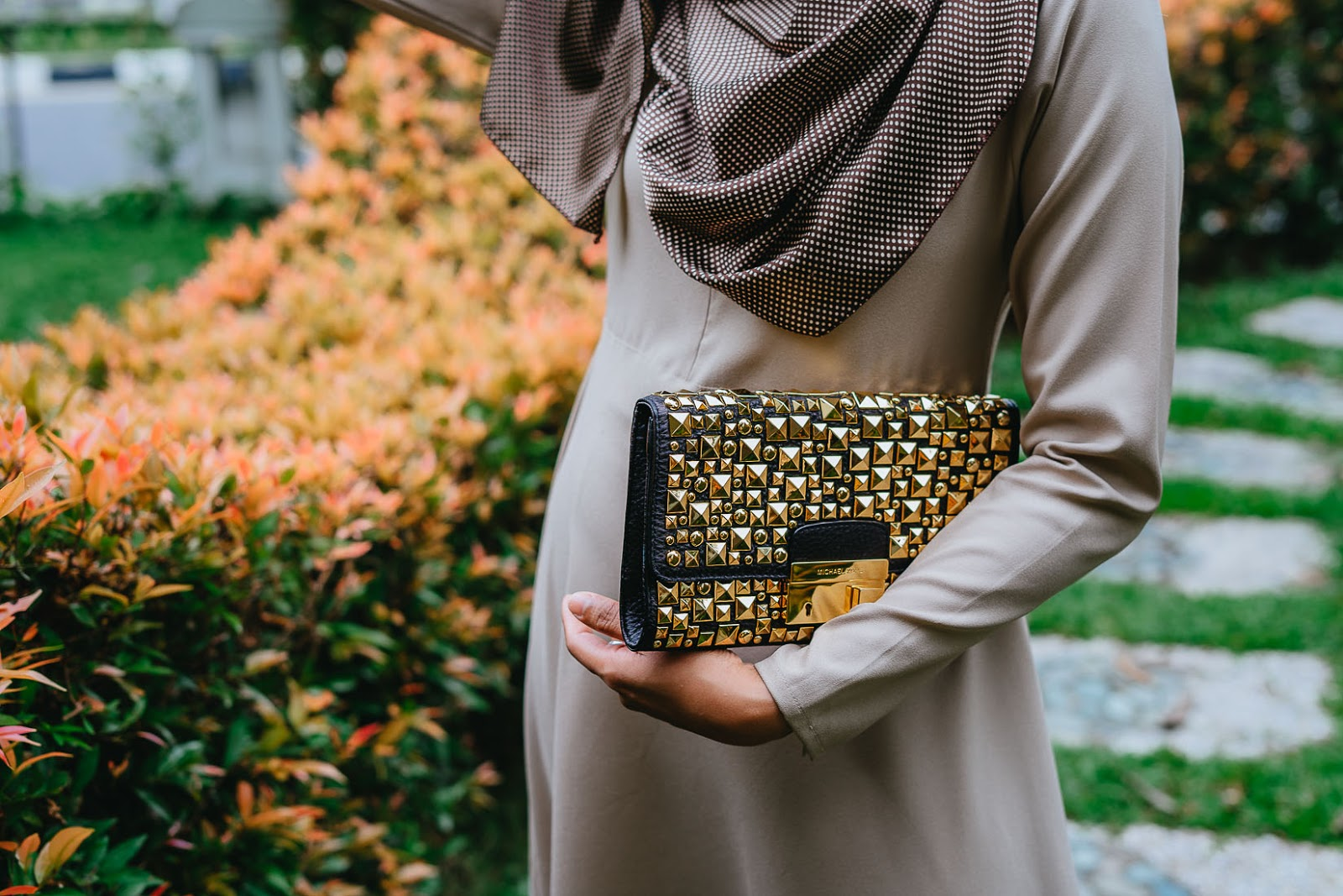 Gold studded Michael Kors black clutch