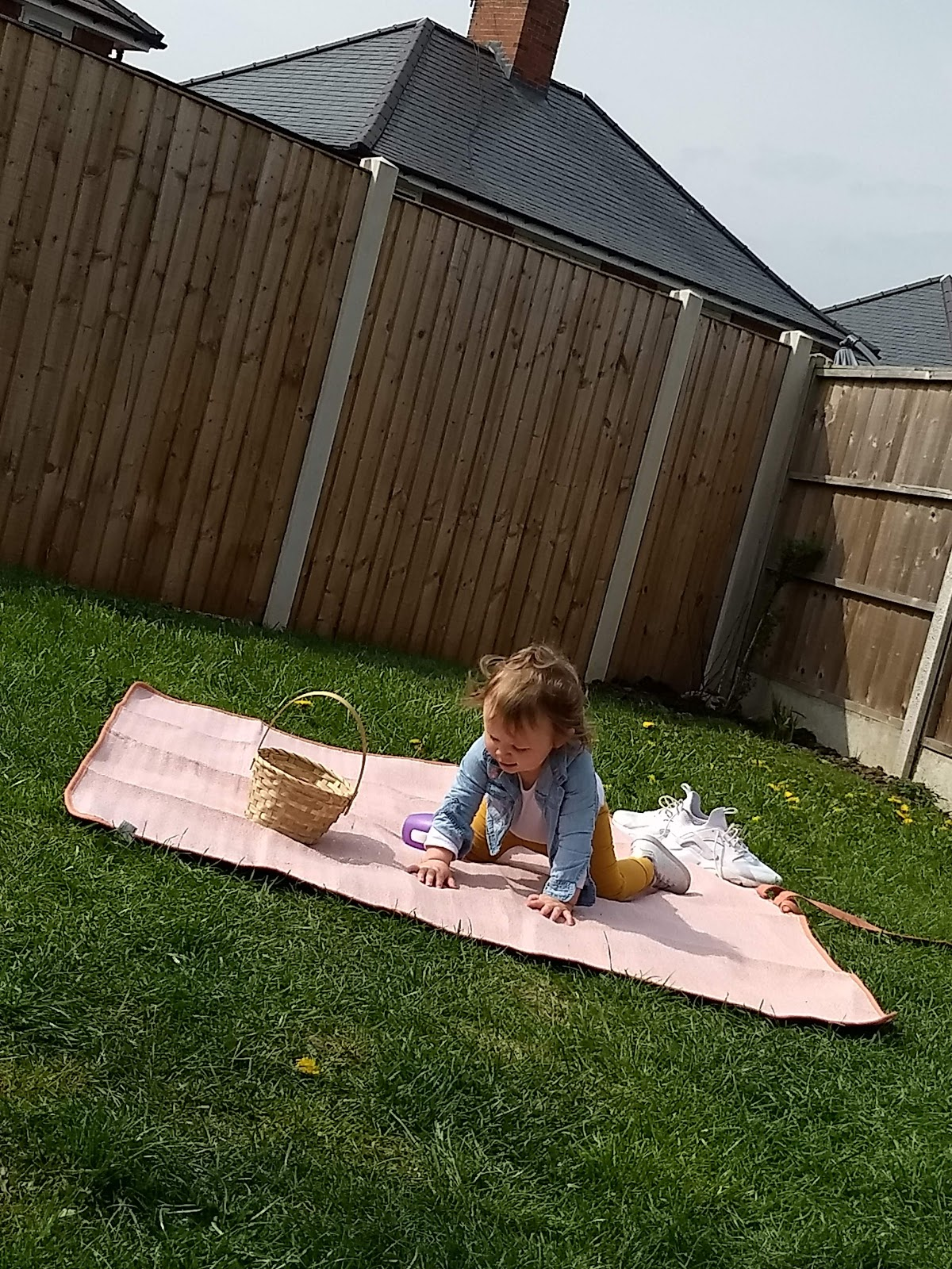 Toddler playing on picnic blanket.