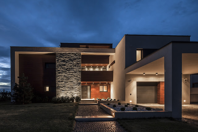 Front facade of Lake Side Duplex House at night