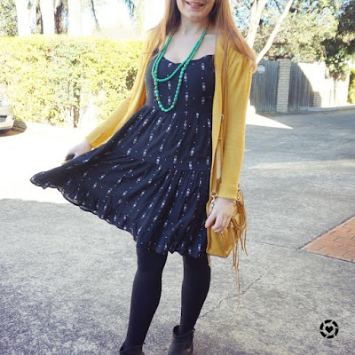 awayfromblue instagram black tiered dress tights mustard yellow cardi ankle boots