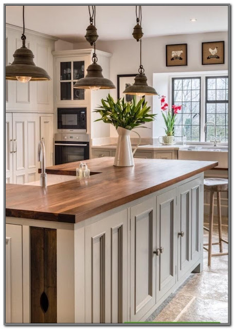 antique white kitchen cabinets with butcher block countertops