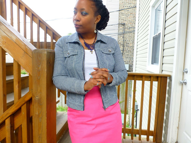 blue eyeshadow on black african american skin and pink pencil skirt