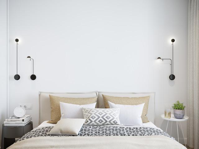Dormitorio con luminarias a cada lado de la cama