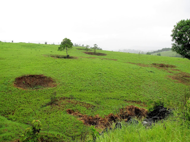 bomb craters across landscape plain of jars laos