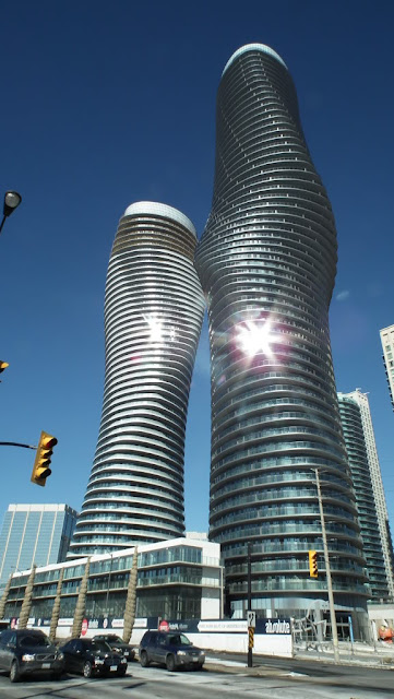 Photo of completed towers as seen from the street looking up